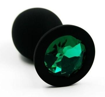 Чёрная силиконовая анальная пробка с изумрудным кристаллом - 7 см.